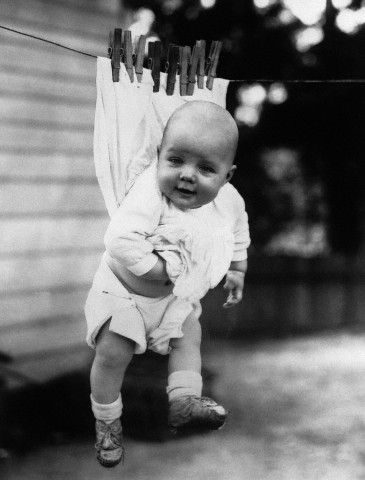 Baby (6-11 months) attached to clothesline