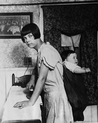 Mother Ironing with Child on Back
